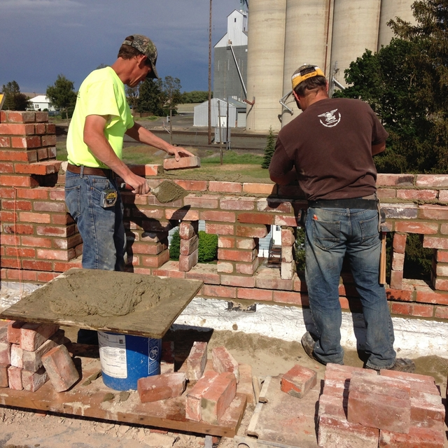 Blayne Foley and crew repairing brick parapet
