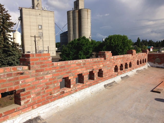 repaired brick parapet