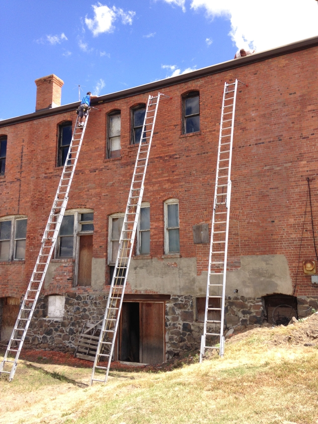tall ladders up to the roof