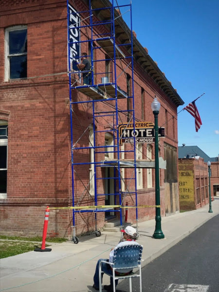 Leslie LePere watches ghost sign restoration