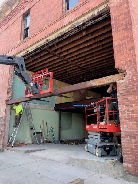 Placing the massive steel beam over the storefront